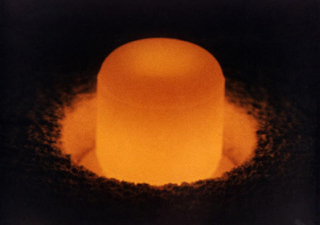 A glowing pellet of plutonium fuel. (Photo: US Department of Energy)
